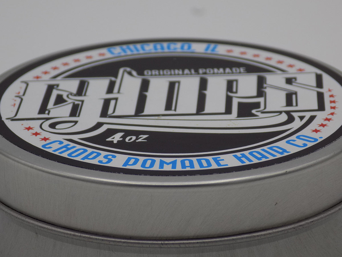 Close up image of the steel casing of the chops pomade.