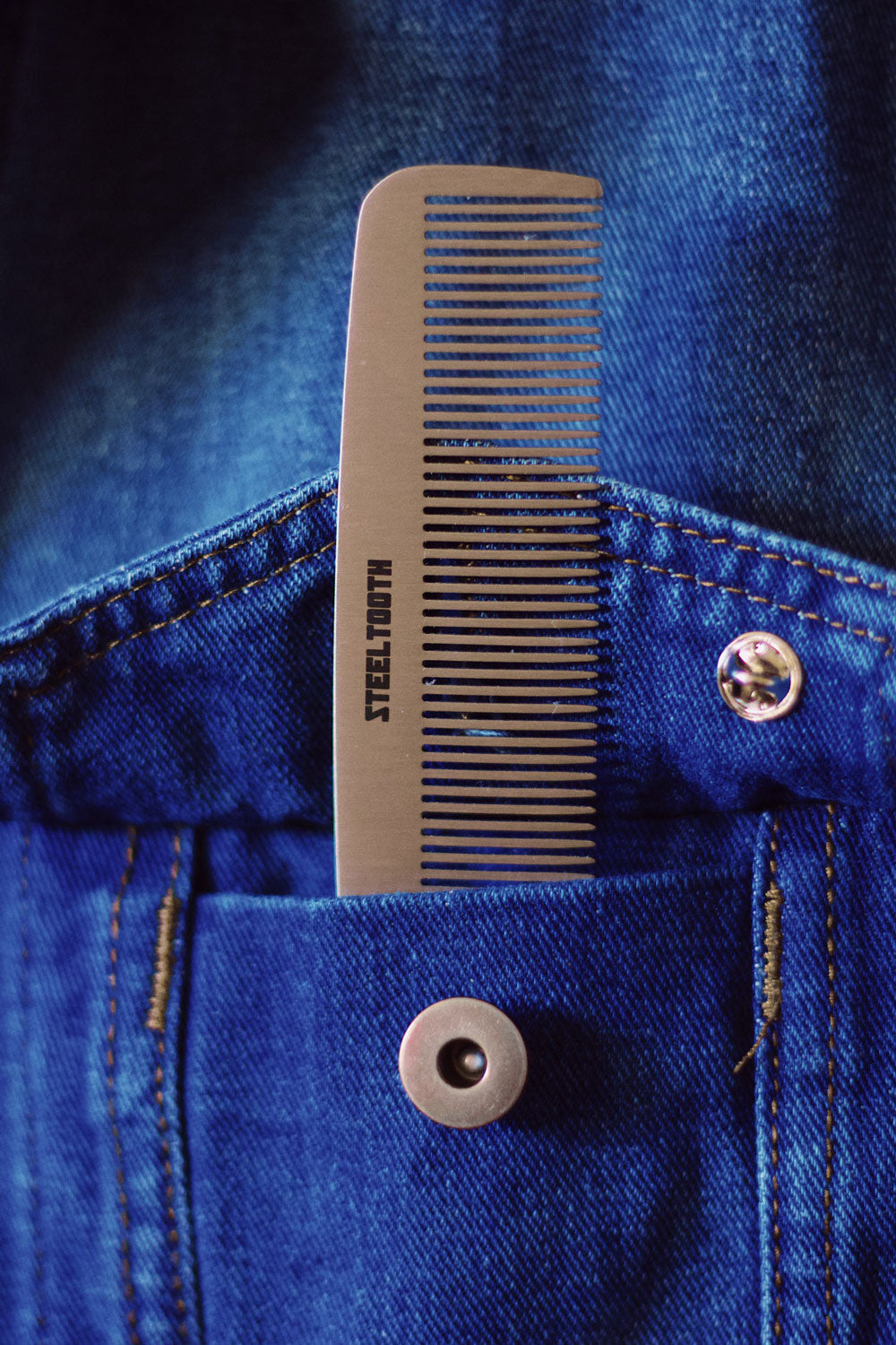 Steeltooth comb in a denim jacket pocket.