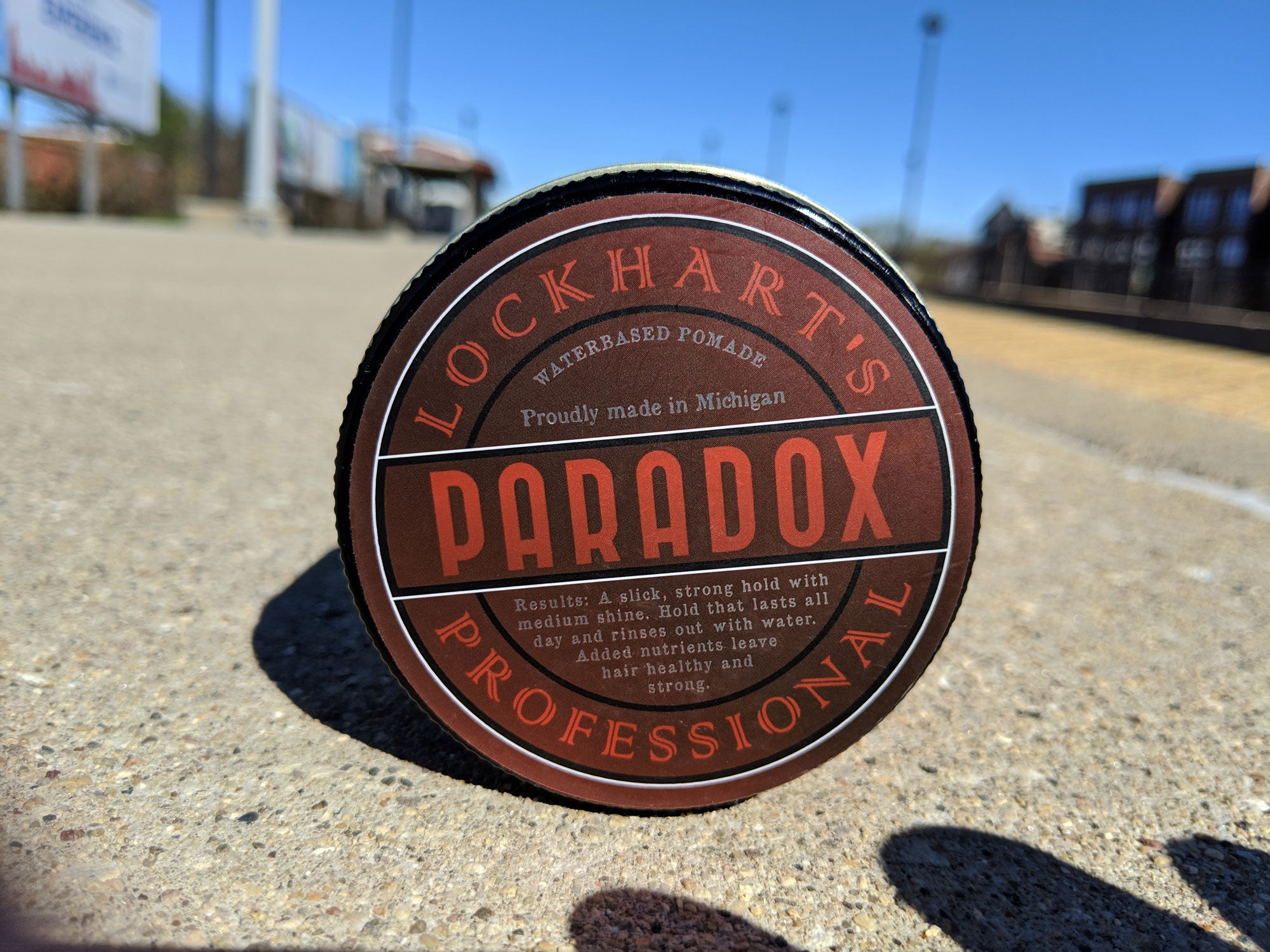 Paradox water based pomade on a train track.