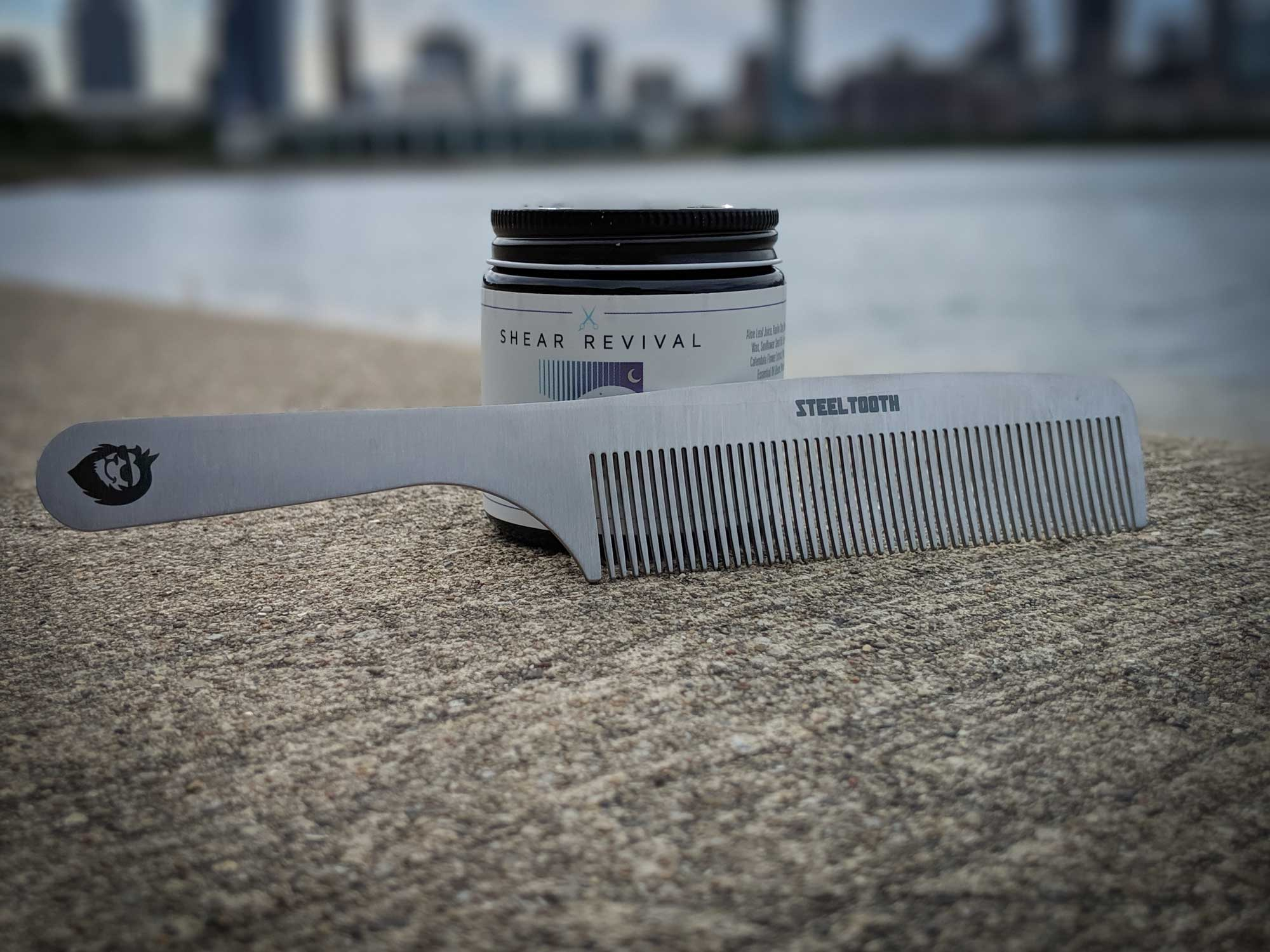 Shear Revival Matte Paste and a steeltooth comb with chicago in the background.