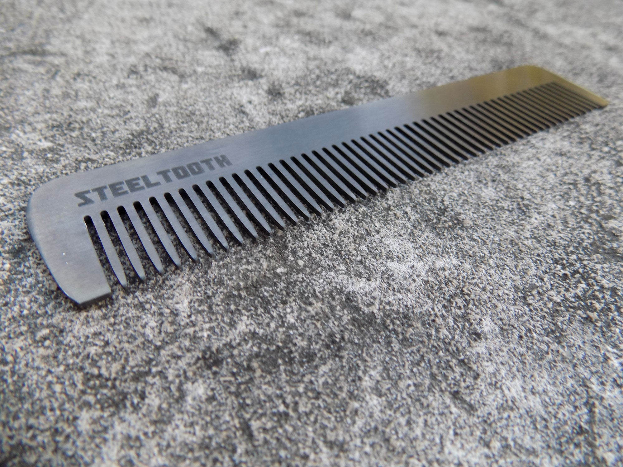 Stainless Steel black comb that works on thick and longer hair.