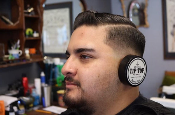 mexican man using tip top pomade