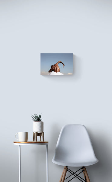 Dancer back, in the nature, blue sky, hand, black skin. Art photo print on the white wall.