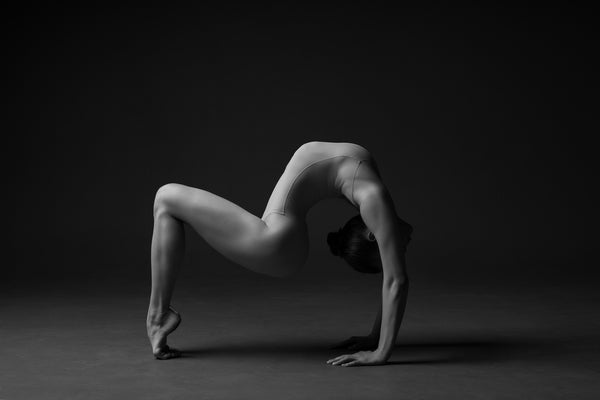 Print image of a female gymnast, contortion, artistic, aesthetic. Photo print studio, colors black and white.