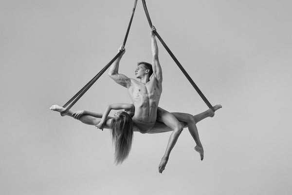 Couple, acrobats, hanging, silk, aesthetically breathtaking, fit bodies, artistic, sexy. black and white photo print.