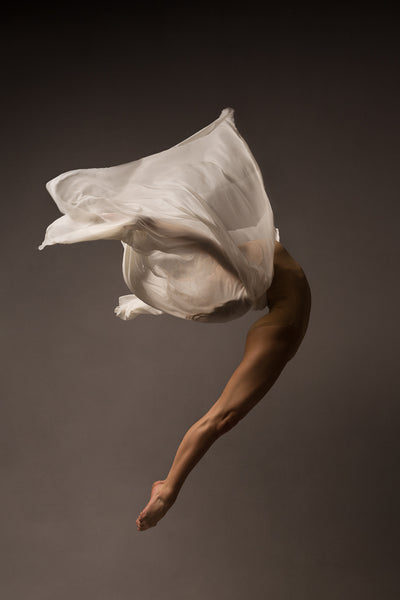 Ballerina, jump, body arch, face covered by white airy fabric.. Photo print studio, in colors, nude bodysuit.