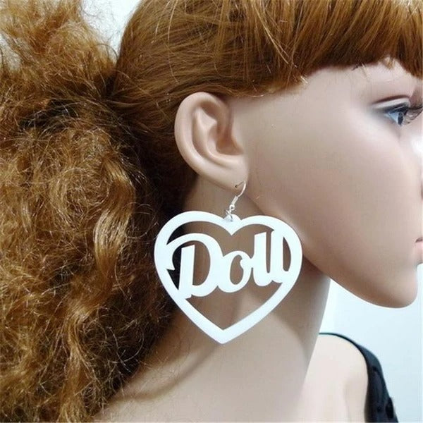 Disco Doll Heart Shaped Earrings in black!