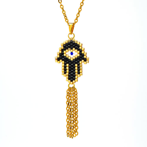 stainless steel Hamsa with beads.