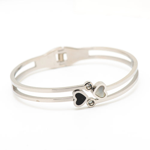 stainless steel bangle with 2 hearts.