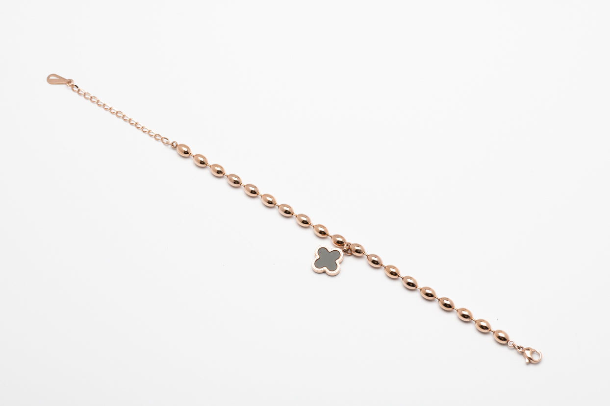 Stainless steel rose gold oval beads with black flower pendent