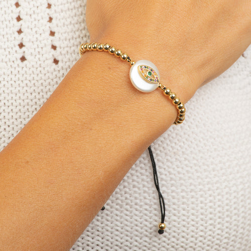 Stainless steel adjustable  gold tone beads with MOP eye charm