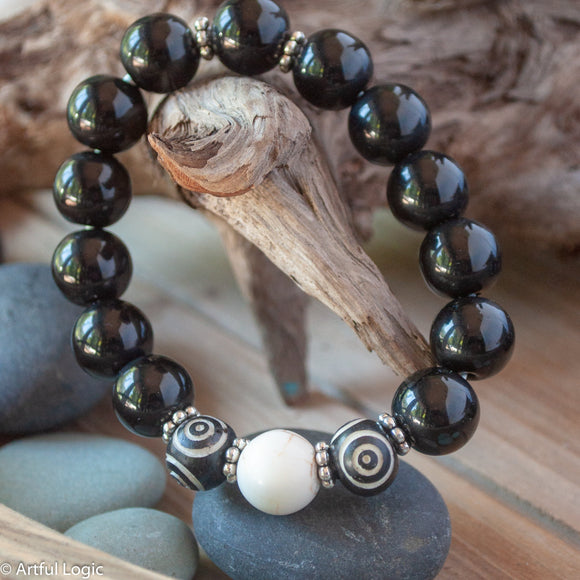 White magnesite, carved bone & black glass bracelet