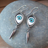 Lover's eye with oxidized dagger earrings