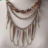 Adjustable multistrand silver, brass, crystal, turtoiseshell, and spikes mixed metal necklace