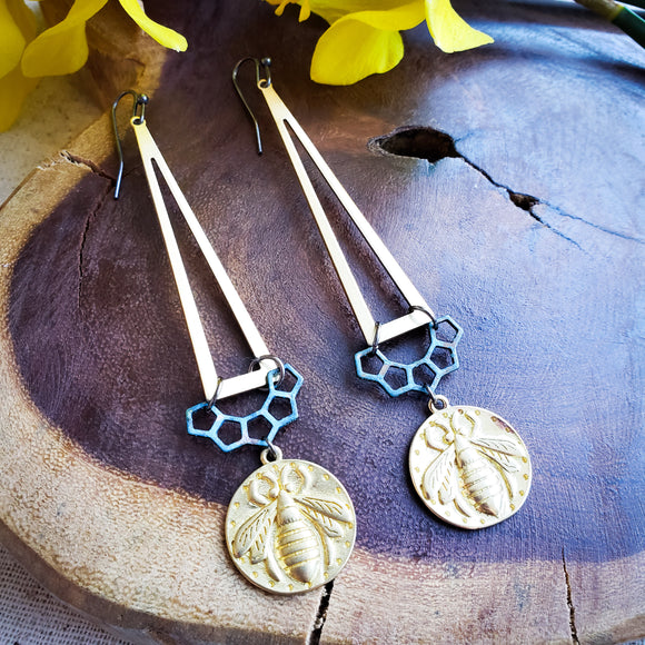 Long geometric dangles with brass medallions