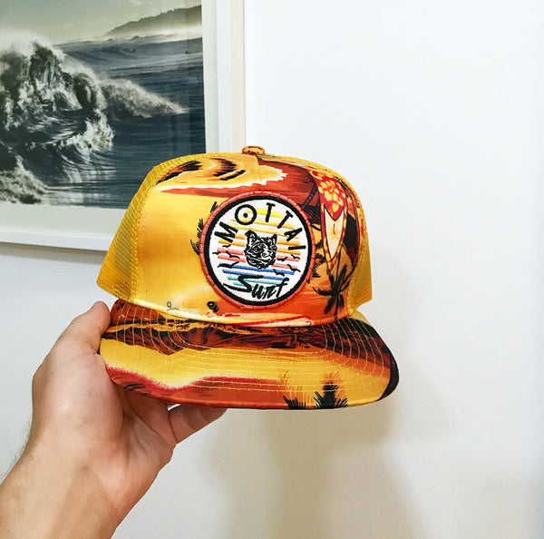 "tropicalia trucker hat, 5 Panel polyester front. Color: yellow/tropical print (print pattern varies slightly on each hat) Mesh back. 3 3/4"" structured crown."