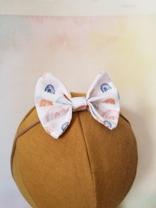 Bows on Nylon headband.