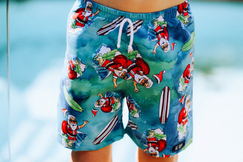 SURFING SANTA SURF SHORTS (Kids, Youth & Adult Sizes)