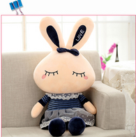 14'' Rabbit plush toy in dark blue skirt.