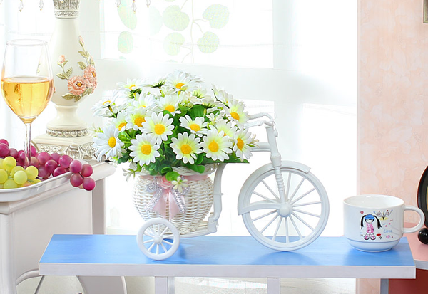 Handmade rattan bike vase with artificial flowers