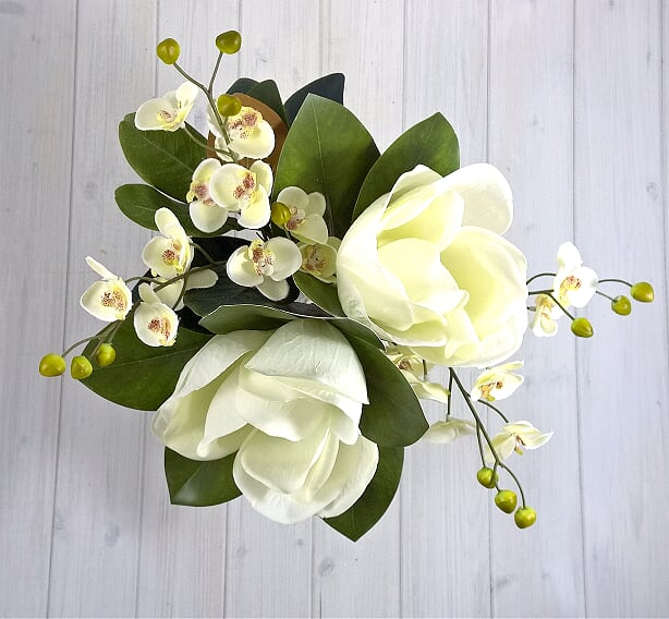 H128 Magnolia and Orchids Hand-tied Arrangement