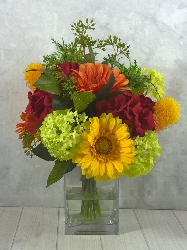 H118 Gerbera, Sea Holly, Geranium, Snowball, Banksia Hand-tied Arrangement