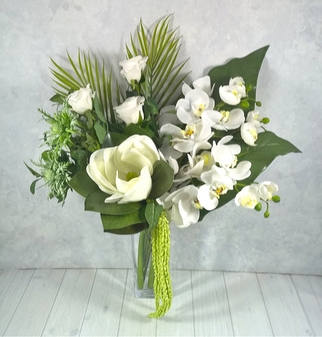 V133 Orchids, Magnolia, Sea Holly, Roses