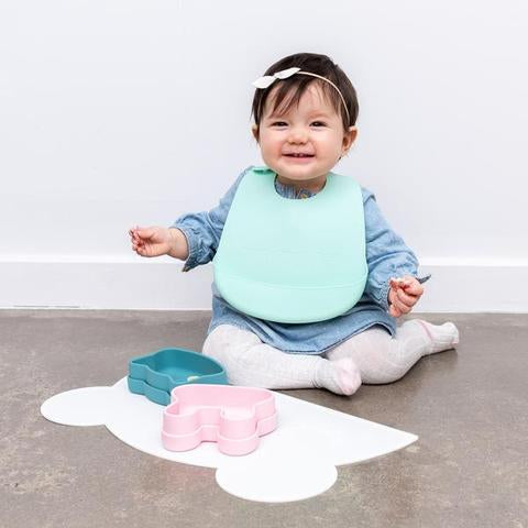 Toddler wearing Mint Green Silicone Catchie Bib as sold by Scarlett Tippy Toes