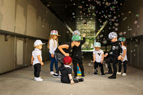 Little Renegade Co Kids wearing collections of caps as sold by Scarlett Tippy Toes