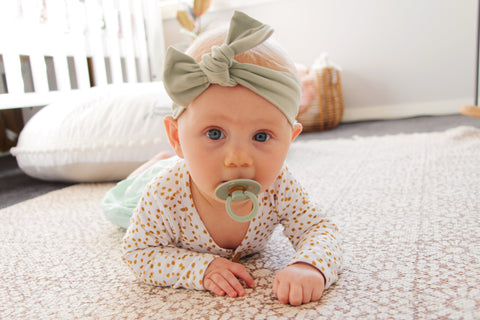 BIBS Dummy worn by Baby Girl in Sage Colour as sold by Scarlett Tippy Toes