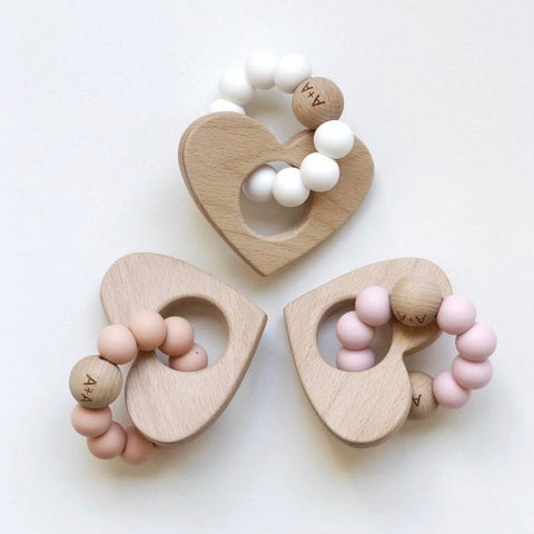 Arabella + Autumn Heart Wooden Teether in Bright Pink