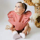 Snuggle Hunny Waterproof Bib in Terracotta with Frills