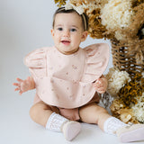 Snuggle Hunny Waterproof Bib in Posey with Frills