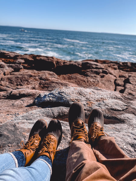 Bean boots next to the ocean in Maine