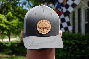 TRUCKER HAT - CHARCOAL AND GREY W/ LEATHER BADGE - Indy Over Everything