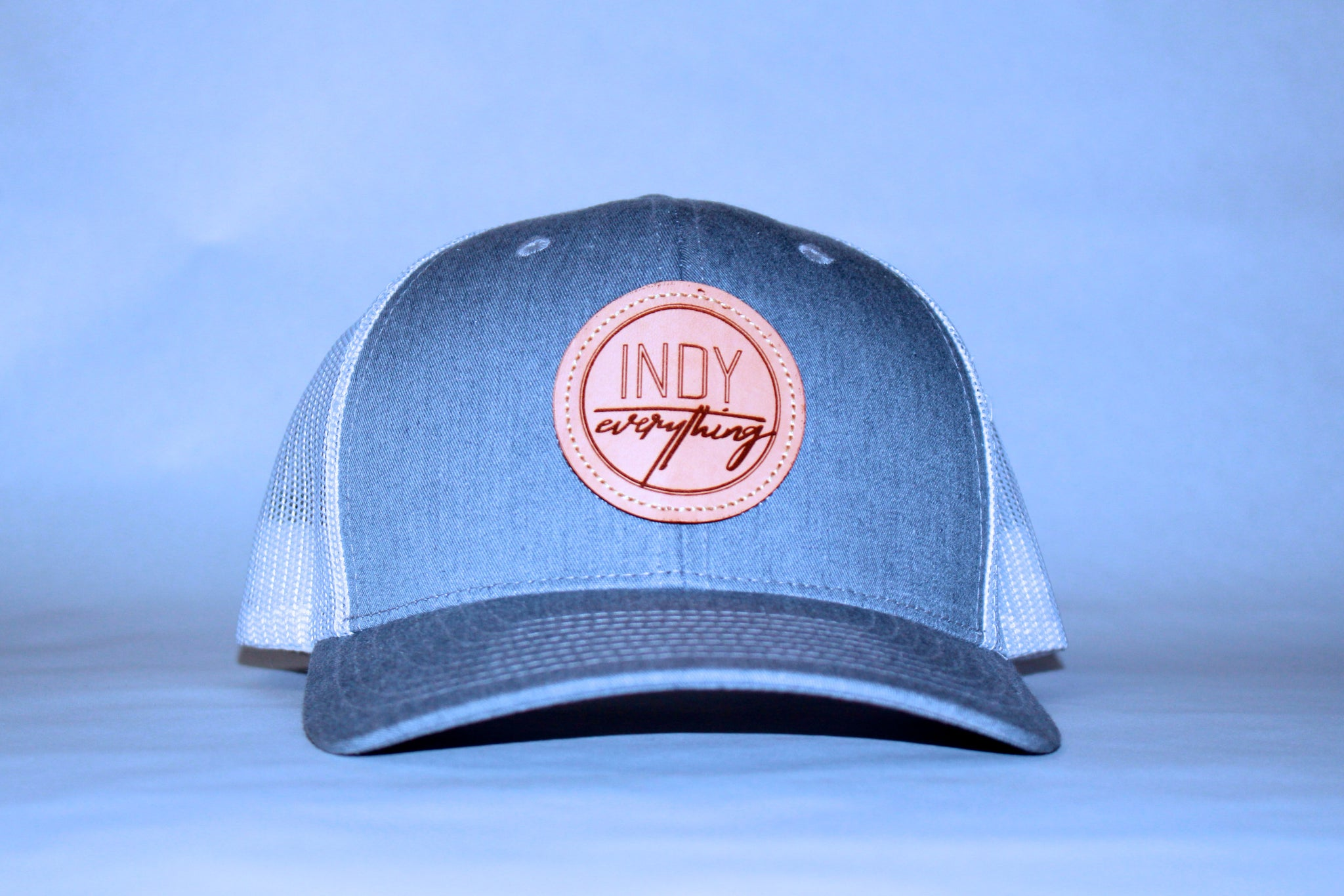 TRUCKER HAT - GRAY AND WHITE W/ LEATHER BADGE - Indy Over Everything