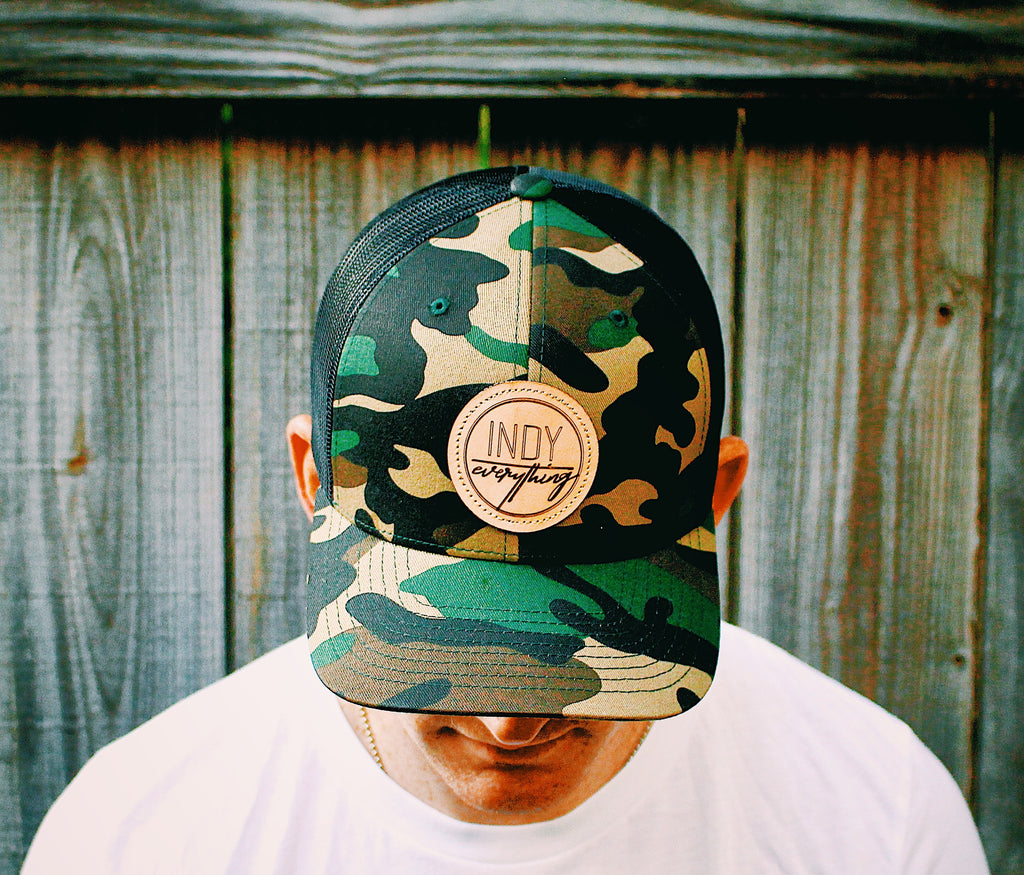 TRUCKER HAT- CAMO AND BLACK W/ LEATHER BADGE - Indy Over Everything