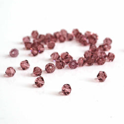 50 4mm crystal bicone beads in mauve, light amethyst