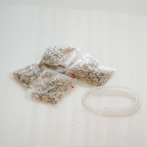 Seedbeads and smooth round frosted beads