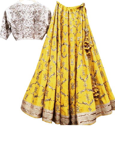 Yellow Colored Partywear Embroidered Silk Lehenga Choli