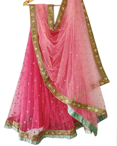 Pink Colored Partywear Embroidered Net Lehenga Choli
