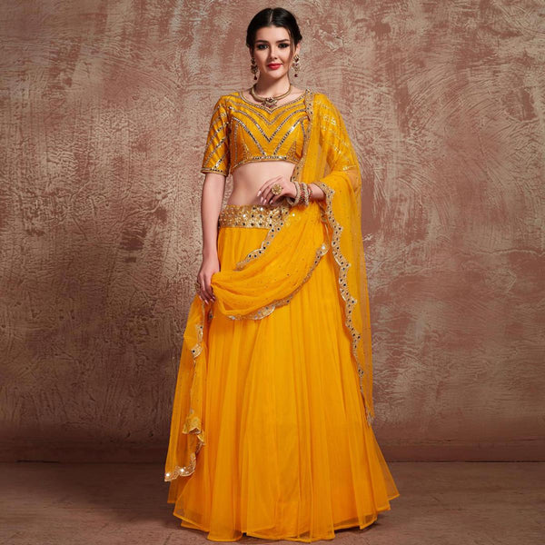 Yellow Colored Partywear Embroidered Soft Net Lehenga Choli
