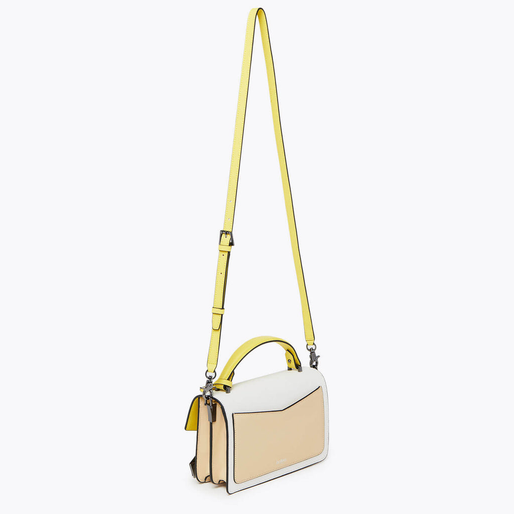 botkier cobble hill structured asymetric flap crossbody in fawn beige, sunburst yellow, and white colorblock