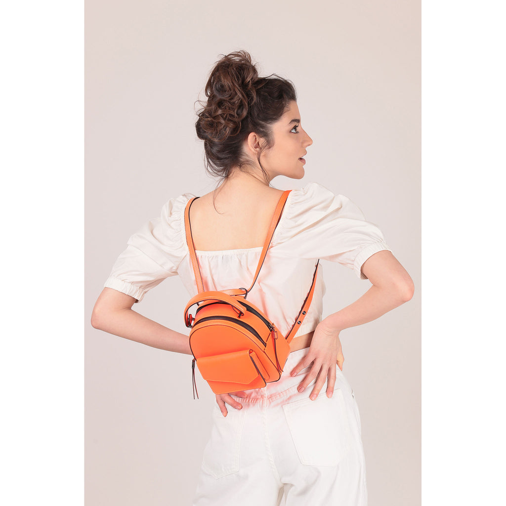 botkier cobble hill mini backpack neon orange on figure