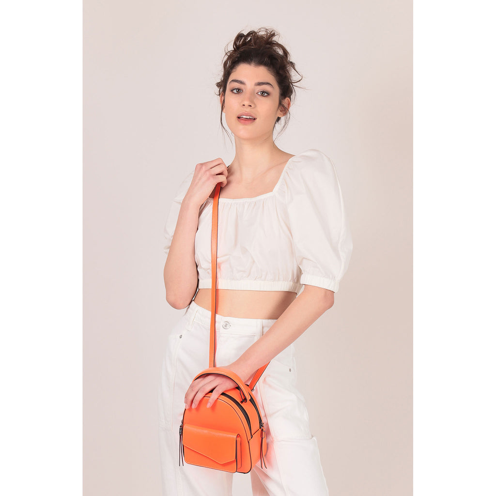 botkier cobble hill mini backpack neon orange on figure crossbody