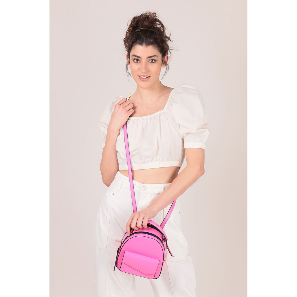 botkier cobble hill mini backpack neon pink on figure crossbody