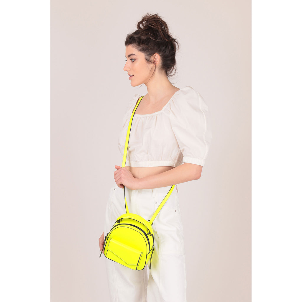 botkier cobble hill mini backpack neon yellow on figure crossbody