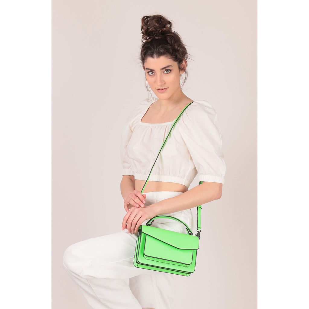botkier cobble hill crossbody neon green on figure crossbody