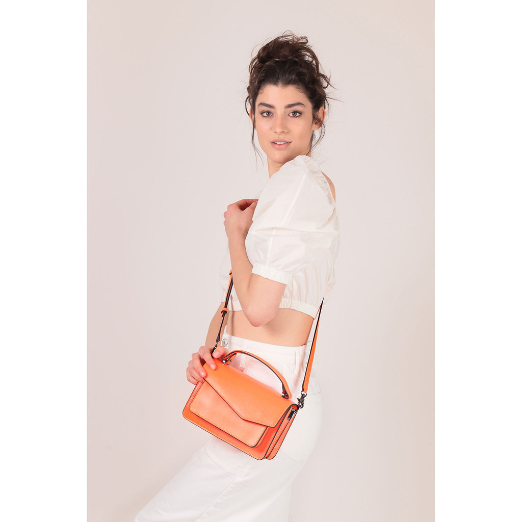 botkier cobble hill crossbody neon orange on figure