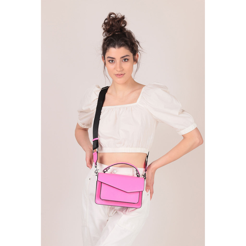 botkier cobble hill crossbody neon pink on figure crossbody